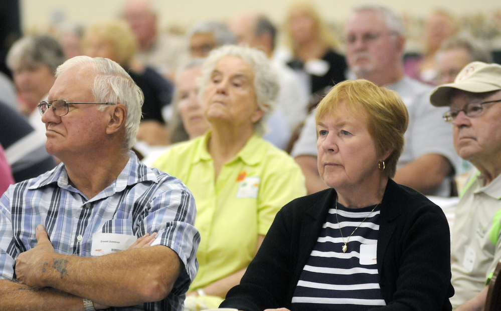 Guests at Scam Jam listen to speakers discuss common scams and fraud targeting the elderly on Thursday at an AARP conference in the Augusta Civic Center.