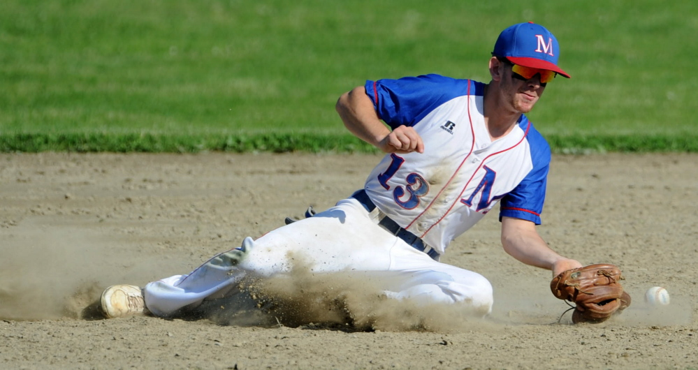 Staff photo by Michael G. Seamans   Messalonskee second baseman Ben Frazee tries to dig out the throw on an Oxford Hills steal attempt during an Eastern A quarterfinal game Thursday in Oakland.
