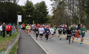 Tom Abello, of Edgecomb, leads the field in the first annual FeedME 5k Road Race for ending hunger. More than 200 walkers and 60 runners raised $33,000 for three dozen food organizations in central Maine during Maine State Credit Union's 10th Annual Walk to End Hunger and the road race on the Kennebec River Rail Trail.