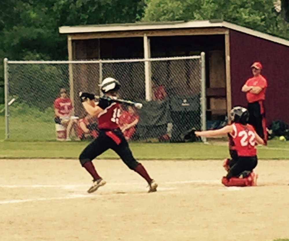 Staff photo by Bill Stewart   Richmond freshman Lyndsey Tilton laces an RBI single during a Western D semifinal game against Vinalhaven on Friday. The Bobcats cruised to a 14-2 victory.
