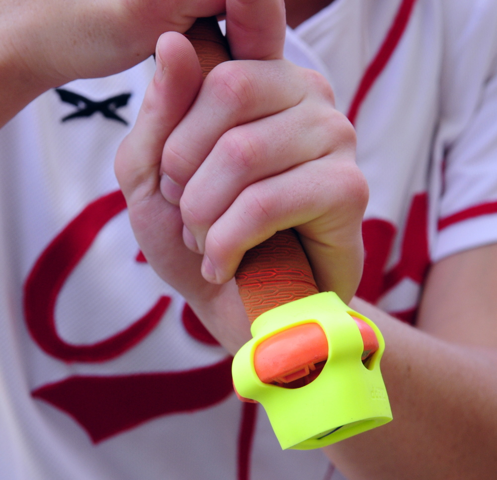 The Zepp sensor is seen on the end of bat held by Cony senior Arika Brochu on Thursday at Cony Family Field in Augusta.