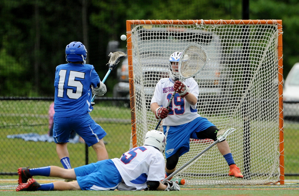 Messalonskee goalie Elijah Teull makes a save on a shot from Lewiston's Alex Rivet during an Eastern Class A semifinal Friday evening at Thomas College in Waterville.
