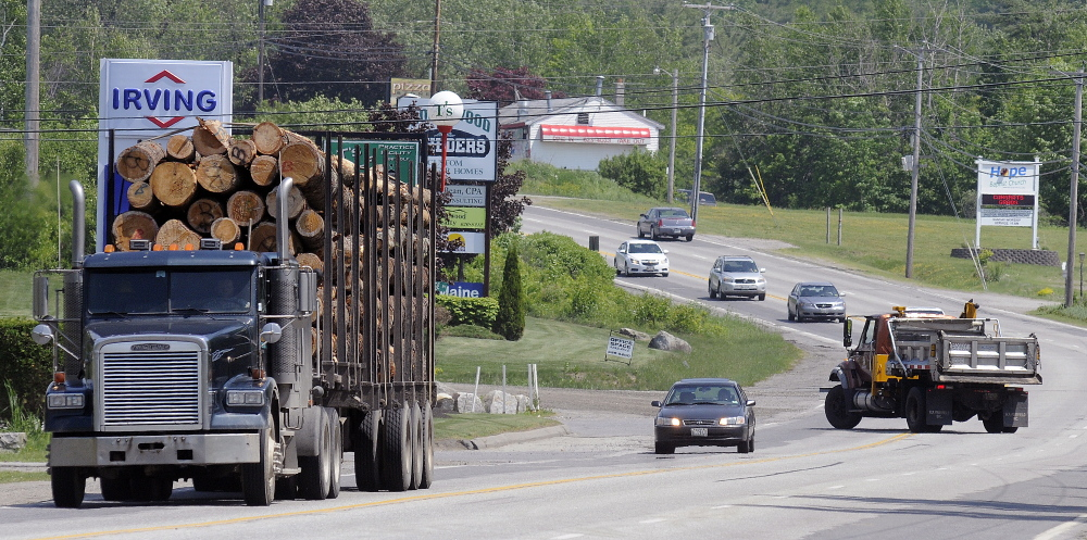 Vehicles travel Thursday on U.S. Route 202 in Manchester, where the Maine Department of Transportation plans to convert the center lane to a left turning lane to reduce accidents.