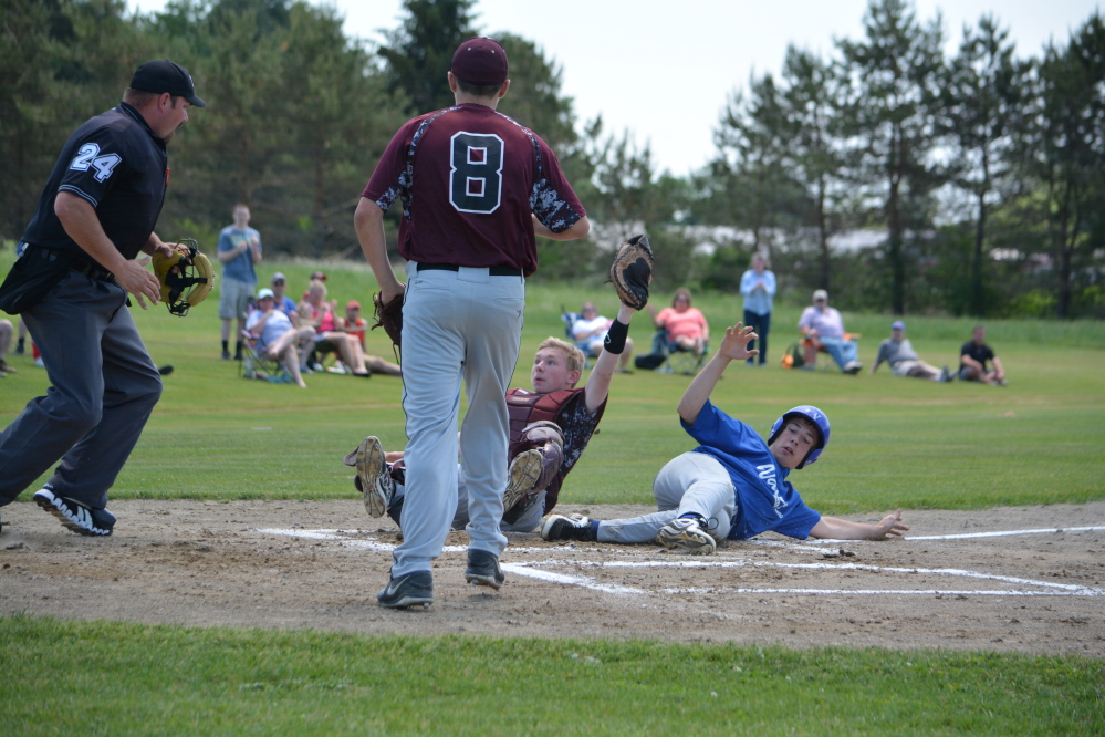 Richmond catcher Brendan Emmons holds onto the ball after a collision at the plate with Valley baserunner Collin Miller in the top of the first inning in a Western D semifinal Saturday in Richmond. Center fielder Tyler Soucy threw Miller out on a bang-bang play. The out proved big as Richmond held on for a 4-3 victory.