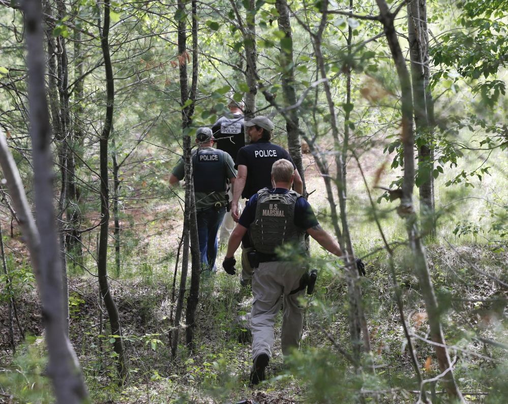 Law enforcement officers search for the ninth day for escaped prisoners David Sweat and Richard Matt on Sunday in Cadyville, N.Y.