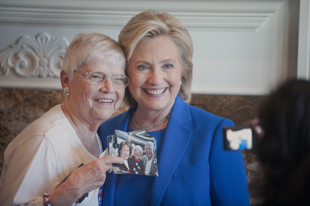 Anita Wendt, of Sioux City, Iowa poses for a photo with Democratic presidential hopeful, former Secretary of State Hillary Rodham Clinton, during a campaign house party Saturday in Sioux City, Iowa.