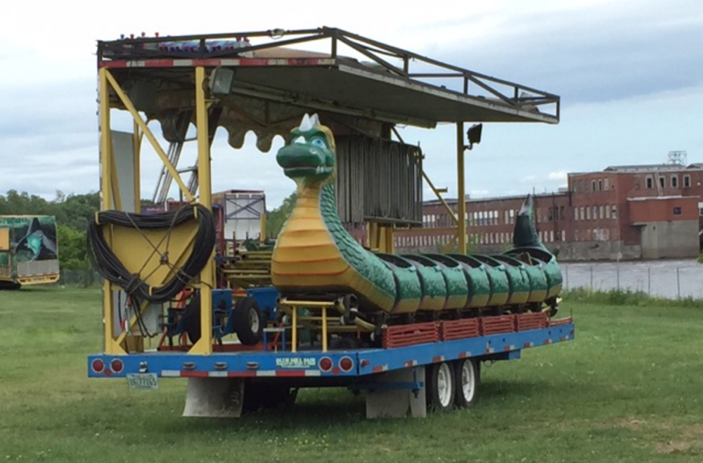 The Dragon Wagon ride, an attraction of Smokey's Greater Shows, sits disassembled and packed up Monday at Head of Falls in Waterville. Three children were hurt Friday night when cars on the ride became uncoupled. The ride was closed down pending an investigation.