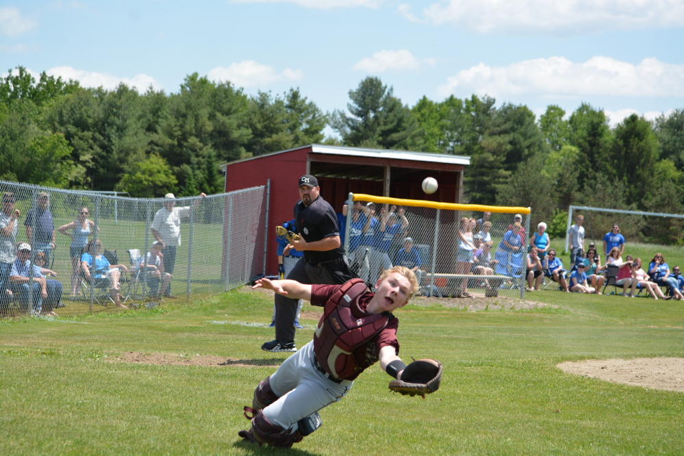 Richmond catcher Brendan Emmons makes an attempt to catch a foul pop-up. The Bobcats will play Searsport for the Western D title today at St. Joseph's College in Standish.