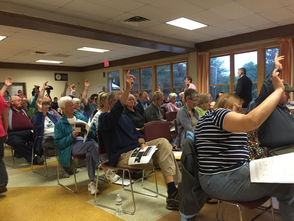 The vote on the Fire Department budget was too close to call by a simple yea or nay vote, forcing a hand count at Wilton's Town Meeting Monday night.