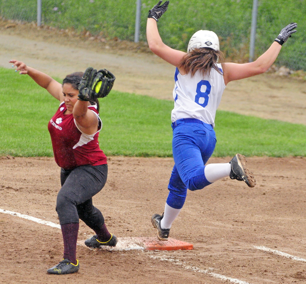 Staff photo by Joe Phelan   Richmond first baseman Kelsie Obie stretches to record the out as Searsport hitter Brittany Ward gets to the bag during Western D regional final Tuesday.