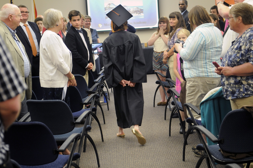 Shaynah-Cherokeigh Raylene Seames, of Bethel, walks on Tuesday into the graduation ceremony for Maine Connections Academy, the state's first virtual public charter school, in Augusta.