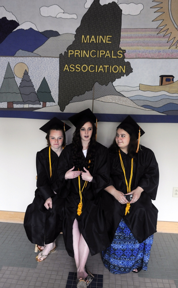 Shaynah-Cherokeigh Raylene Seames, left, of Bethel, Serena Billie-Jo Gorham, of Lyman, and Maddy Dexter, of Portland, wait Tuesday for friends to arrive at their graduation from Maine Connections Academy, the state's first virtual public charter school, in Augusta. Four students attended the ceremony for graduates of the publicly funded school that is operated by the for-profit firm Connections Academy, the Baltimore-based subsidiary of education publishing giant Pearson PLC.
