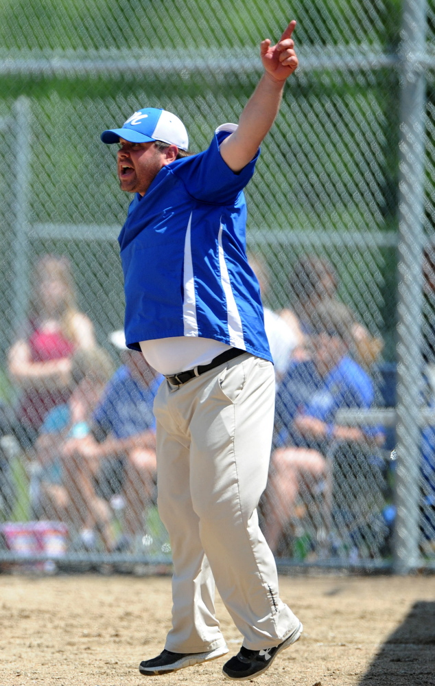 Madison coach Chris LeBlanc waves runners home during a Western C semifinal against Monmnouth in Madison on Saturday.