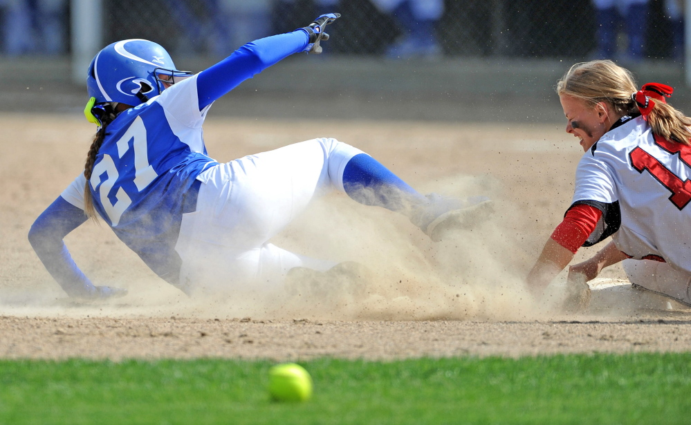 Madison baserunner Erin Whalen (27) slides safely into second base as Hall-Dale's Eva Shepherd tries to handle the throw during the Mountain Valley Conference title game earlier this month. The Bulldogs will play for the Western C title on Wednesday.