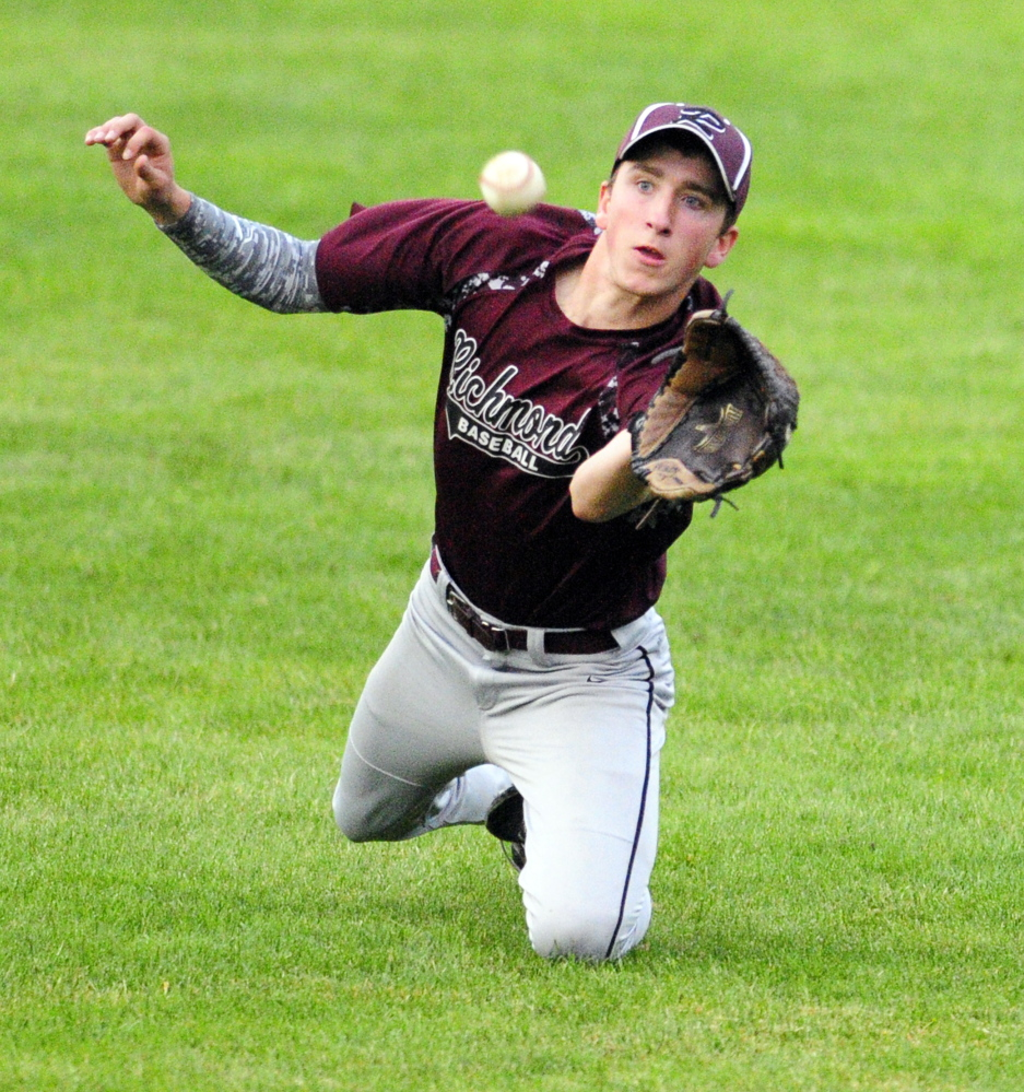 Richmond right fielder Brady Johnson catches a ball to start a double play that he finished by throwing to second base to force out a Searsport baserunner during the Western D title game Tuesday at Larry Mahaney Diamond at St. Joseph's College in Standish.