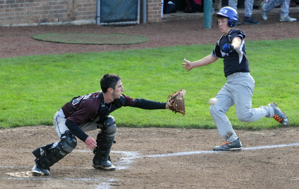 Richmond catcher Tyler Soucy waits for the throw to nab Searsport baserunner Kyle Moore at home during the Western D title game Tuesday at Larry Mahaney Diamond at St. Joseph's College in Standish.