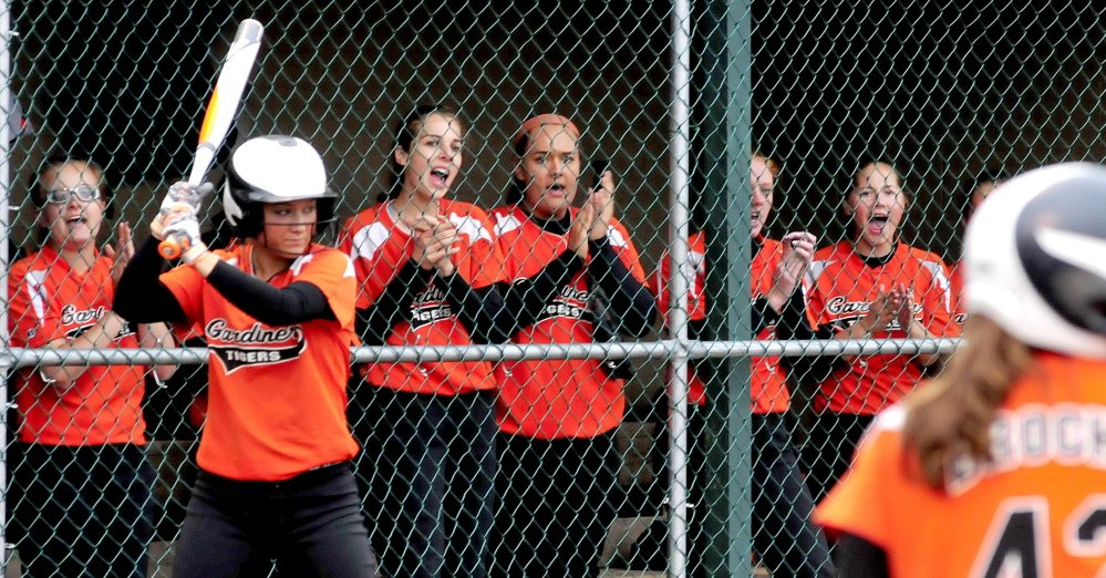 Members of the Gardiner softball team cheer on teammates during the Eastern B final Tuesday night against Hermon at Brewer High School.
