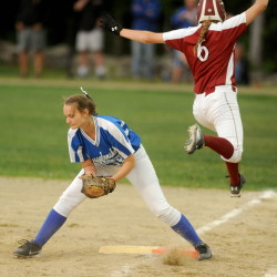 Messalonskee's Dakota Bragg, left, digs out the ball on a play at first base as Bangor High School's Lilli Wiseman (6) jumps over her leg to tag first in the Eastern A final Wednesday at Cony High School in Augusta. Bragg is hitting about .380 to lead a versatile and potent Eagles lineup.