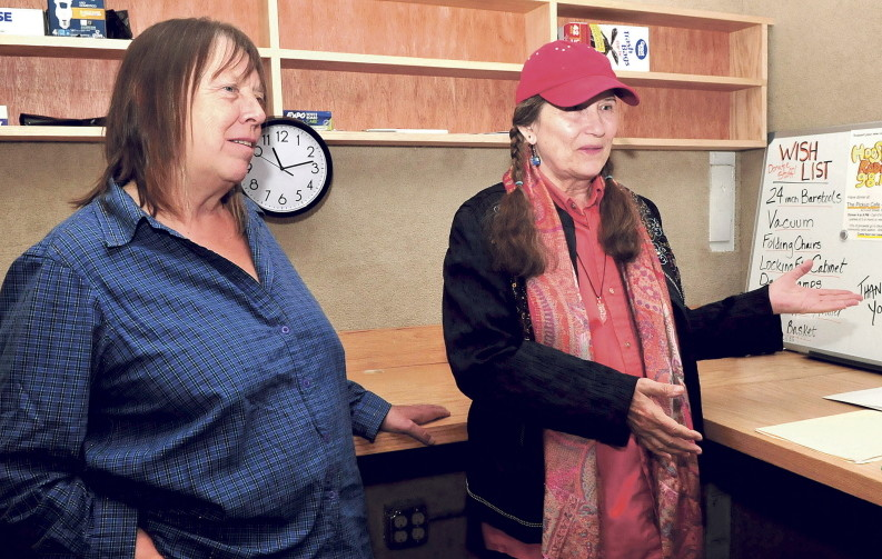 Lolly Phoenix, left, and WXNZ-LP 98.1 radio station manager Annie Stillwater Gray discuss further fundraising Tuesday as they work to make the station operational in the former Somerset County Jail in Skowhegan.
