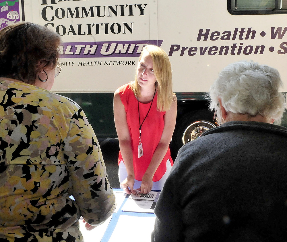 Laure Johnson, of Seniors Plus, speaks with attendees Thursday at the Senior Resource Fair in Wilton. Johnson was a keynote speaker at the event.