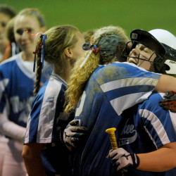 Staff photo by Michael G. Seamans   Messalonskee High School's Kirsten Pelletier, left, celebrates with teammate Hannah Duperry after the Eagles toppled Bangor 3-2 in eight innings of the Eastern A title game Wednesday night. The Eagles will play Scarborough in the Class A state game on Saturday at noon.