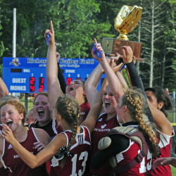 The Richmond softball team hoists the gold glove trophy emblematic of winning the Class D state championship Saturday on Bailey Field at St. Joseph's College in Standish. It was its third straight state titleand the seventh for head coach Rick Coughlin during his 29 year coaching career.