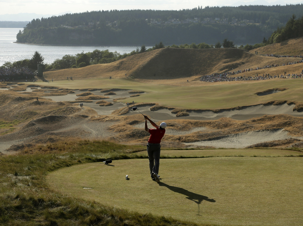Jordan Spieth watches his tee shot on the 14th hole during the third round of the U.S. Open golf tournament at Chambers Bay on Saturday, June 20, 2015 in University Place, Wash.
