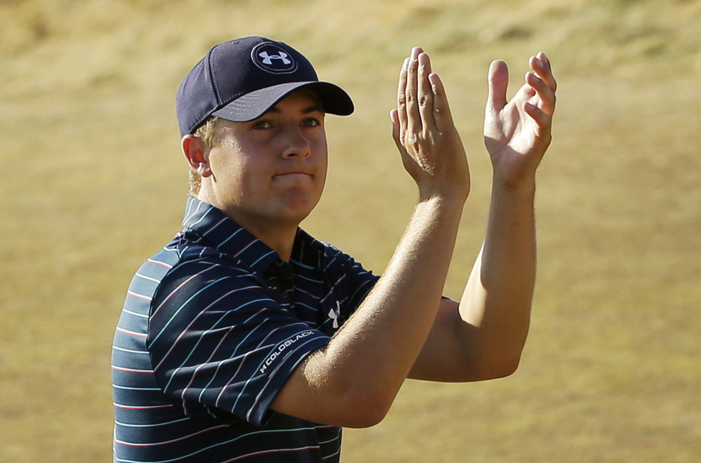 Jordan Spieth claps after finishing the final round of the U.S. Open golf tournament at Chambers Bay on Sunday, June 21, 2015 in University Place, Wash. Spieth won the championship.
