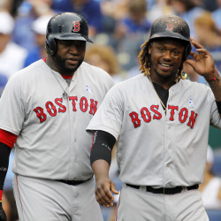 Boston Red Sox's David Ortiz, left, and Hanley Ramirez, right, head to the dugout after scoring on a Xander Bogaerts double in the fifth inning Sunday against the Kansas City Royals. The Red Sox won 13-2.