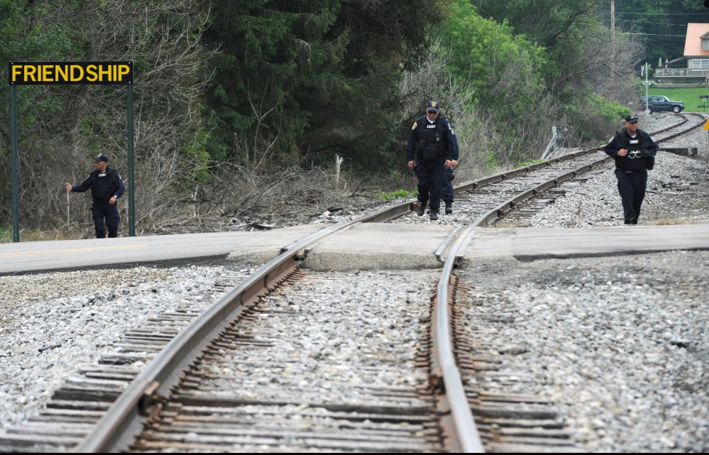 New York State Department of Corrections officers search the railroad tracks after a possible sighting of the two murder convicts who escaped from a northern New York prison two weeks ago in Friendship, N.Y.
