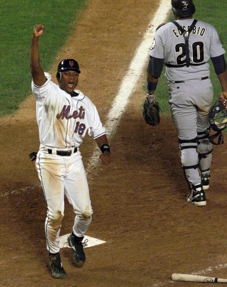 The Associated Press In this Aug. 23, 1999, file photo, New York Mets' Darryl Hamilton celebrates as he scores the game-winning run on a Matt Franco hit to left field in the bottom of the ninth inning that gave the Mets a 3-2 victory over the Houston Astros in a baseball game at Shea Stadium in New York.