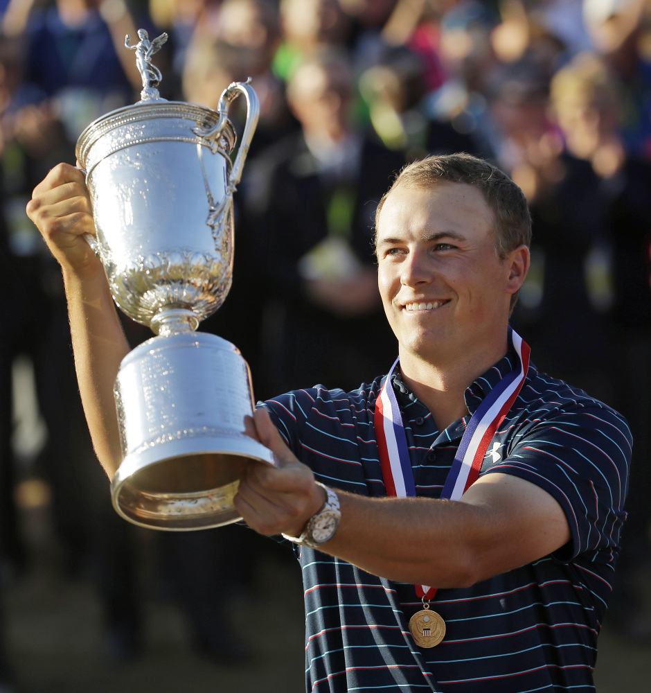 AP photo   In this Sunday photo, Jordan Spieth holds up the trophy after winning the U.S. Open at Chambers Bay in University Place, Wash. Spieth loves golf history, which is appropriate for someone quickly becoming part of it.
