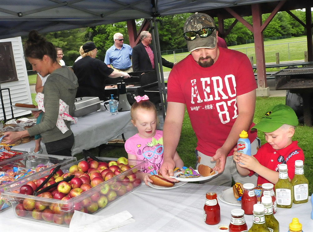 Steven Proctor and his kids Desirae and Dylan take part in a free lunch on Monday during the kickoff of the food summer program sponsored by AOS 92 and the USDA that serves children under 18 in Waterville, Winslow and Vassalboro.