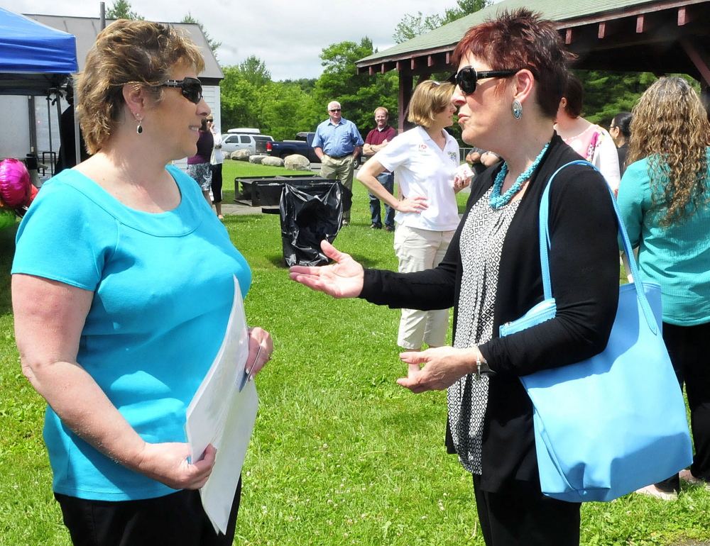 AOS 92 Food Service Director Paula Pooler, left, and Jan Kallio of the USDA, discuss the summer food program during a kickoff of the program in Waterville on Monday.