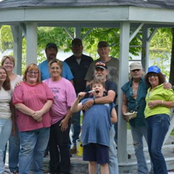 In front, from left, are Mercy Smith, Sue Fournier, Dee Robinson, Kathy Hargreaves, Leon Volinsky, with grandson Julin, and Mac and Donna MacIsaac. In back, from left, are Roderick Smith, Frank Robinson and County Director Tim Fournier.