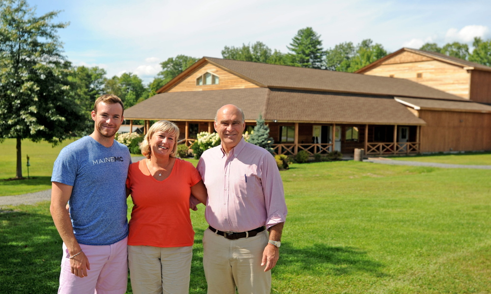 John and Kim Wiggin stand with their son Matthew on Aug. 20, 2014 at the New England Music Camp in Sidney.