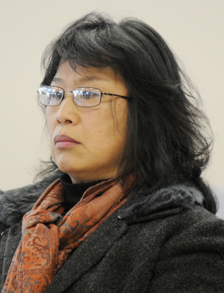Jennifer Ma Sims, of East Winthrop, is shown at the Maine Human Rights Commission hearing in December 2013, when the commission voted 3-1 to find reasonable grounds to believe the former payroll and benefits clerk in the Winthrop and Fayette school system was subjected to illegal workplace discrimination and retaliation.