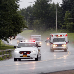 Police escort ambulances from an area where law enforcement officers were searching for convicted murderer David Sweat, one of two convicted murderers who broke out of a maximum-security prison near the Canadian border in Constable, N.Y.