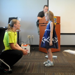 Sgt. Jennifer Weaver of the Waterville Police Department works through a lost-in-public demonstration with Dominique Giroux-Pare, 6, in the radKIDS Personal Empowerment Safety Education class at the Waterville police station on Wednesday. Waterville police Officer Damon Lefferts is shown helping with the role-playing in background.