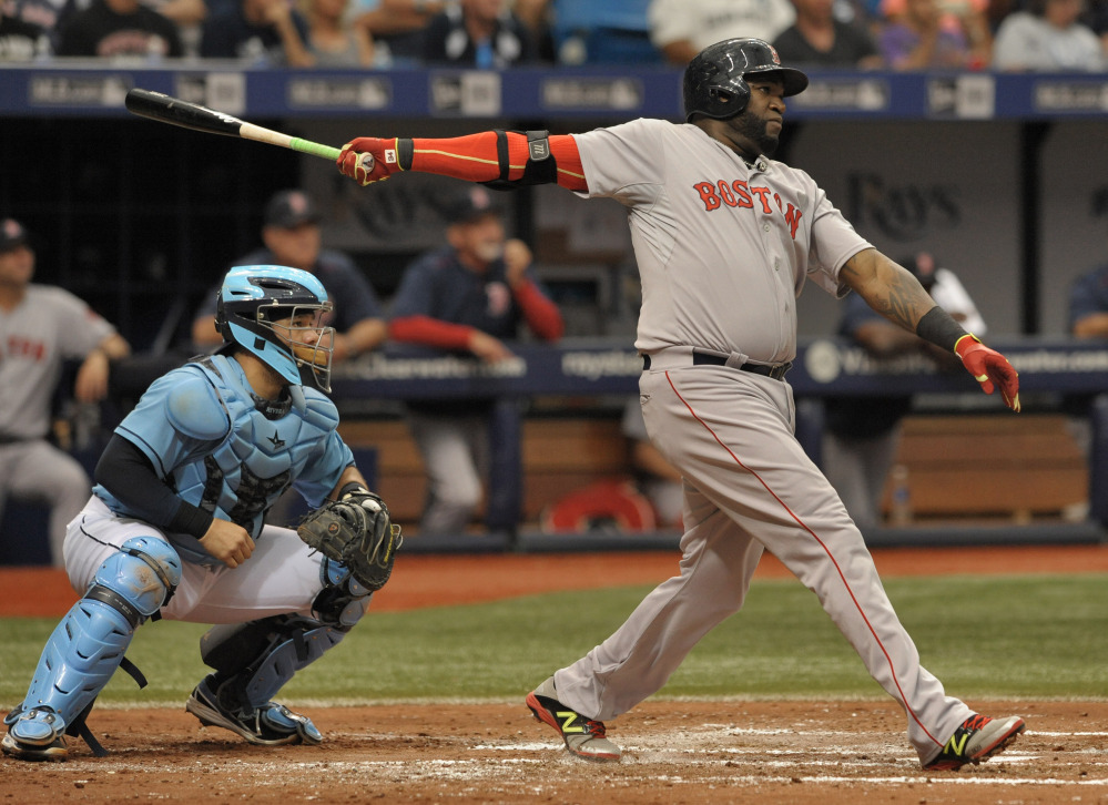 Tampa Bay Rays catcher Rene Rivera, left, looks on as Boston Red Sox designated hitter David Ortiz hits a two-run home run to right during the fourth inning Sunday in St. Petersburg, Fla. The Red Sox won 5-3.