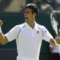 Novak Djokovic of Serbia celebrates defeating Philipp Kohlschreiber of Germany in their men's singles first round match at the All England Lawn Tennis Championships in Wimbledon, London, Monday.