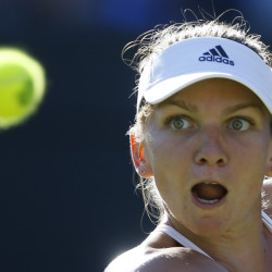 AP photo   Simona Halep watches the ball during the singles first round match against Jana Cepelova on Tuesday at the All England Lawn Tennis Championships in Wimbledon, London.