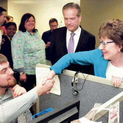 U.S. Sen. Susan Collins, R-Maine, shakes hands with Barclaycard company employee Ben Tucker during a tour of the renovated call center in Wilton on Tuesday. Looking on is CEO Curt Hess.