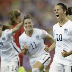 AP photo   United States' Carli Lloyd (10) celebrates with teammates Ali Krieger (11) and Morgan Brian after scoring on a penalty kick against Germany during the second half of a World Cup semifinal Tuesday in Montreal, Canada.