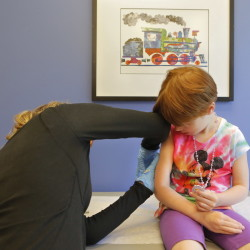 Kiara Boisvert, 5, gets a varicella booster vaccination Thursday from Amy Moran, a clinical assistant at Intermed in South Portland. Photo by Gregory Rec/Staff Photographer