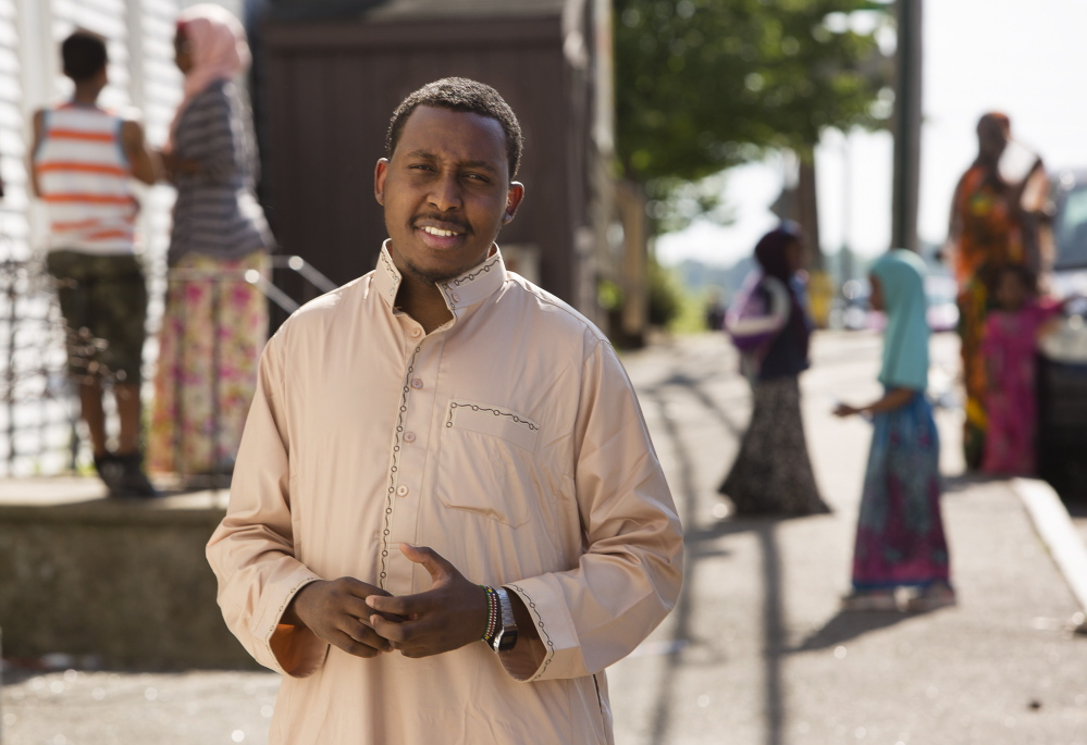 """Osman Bashir, 25, who immigrated to the U.S. about 10 years ago, last year earned his associate degree in criminal justice and is considering applying for a job with the police force. """"I think it would be a big step for Lewiston"""" to have a Somali officer, he said."""
