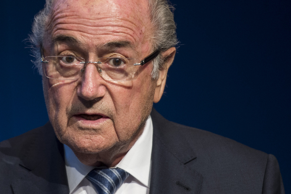 FIFA President Sepp Blatter speaks at a news conference Tuesday at FIFA headquarters in Zurich, Switzerland. He said he will resign and promised to call for new elections to choose his successor.