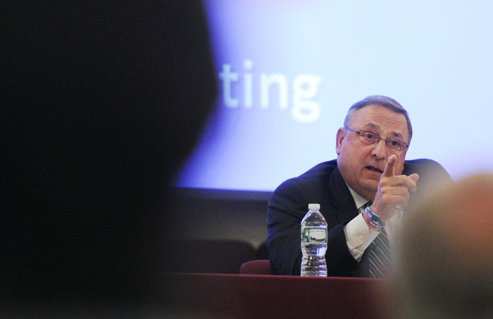 Gov. Paul LePage speaks at a town hall forum Tuesday at Open Door Bible Baptist Church in Lisbon. It was his tenth such session since February as he works to build public support for his plan to dramatically reform tax policy in the state.