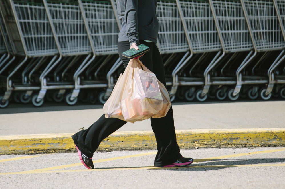 "Carrying bags to her car Wednesday, Joanne MacLeod of Kennebunk was disappointed about losing the Biddeford store: ""I love this Shaw's. I'm going to have to call my husband on the way home and tell him the news – he knows this is my store."""