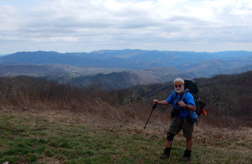 Carey Kish stands atop 5,000-foot Cheoah Bald in the Stecoahs of North Carolina on the Appalachian Trail. This section is part of the 531,000-acre Nantahala National Forest.